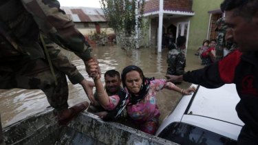 Indian army soldiers rescue a Kashmiri woman from her flooded house in Srinagar.