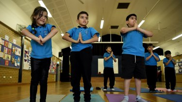 Refugee children at Liverpool West Public School are doing yoga classes to learn relaxation techniques.