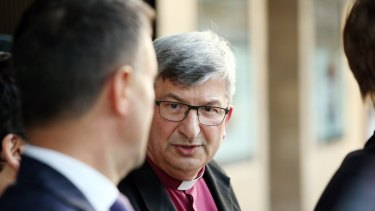 Bishop Roger Herft leaving Newcastle Court House after a session of the Royal Commission into Institutional Responses to Child Sexual Abuse in the Newcastle Anglican Diocese in August.