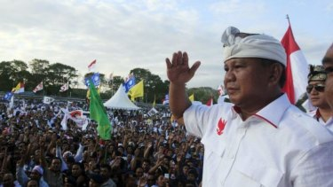 Indonesian presidential candidate Prabowo Subianto greets his supporters during his election campaign rally in Bali on Sunday. Indonesia will hold its presidential poll on July 9.
