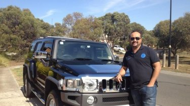 Education salesman Sandeep Sood and his new Hummer.