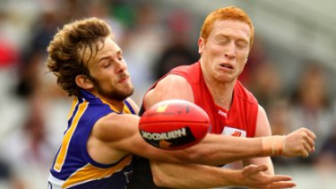 West Coast's Will Schofield spoils Melbourne midfielder Matthew Bate.