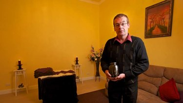 Ian Robertson in his pet chapel. He can also provide a hearse and performs cremations.