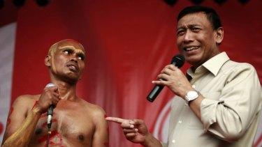Chief Security Minister Wiranto (right) denied that the measure aimed to limit freedom of assembly.