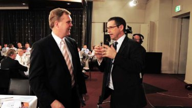 Gap . . . the shadow communication minister Tony Smith with Stephen Conroy at the National Press Club yesterday.