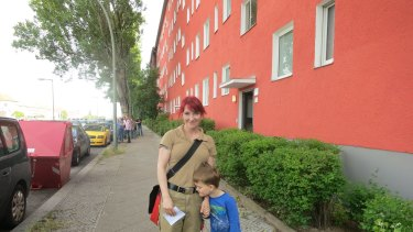 Apprentice carpenter Lea Schmeling with her son Henry outside a 51sqm rental property she, and 30 other groups, had just inspected in Berlin.