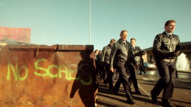 "Police arrive at Swanson Dock, Melbourne. They pass graffiti which reads ""No Scabs"". April 18, 1998."