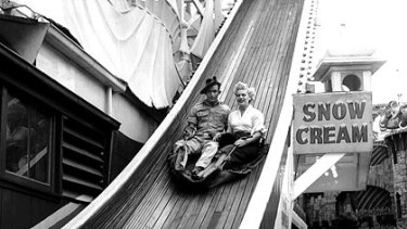An Australian soldier and female friend on Luna Park's Jack and Jill slide in 1954.