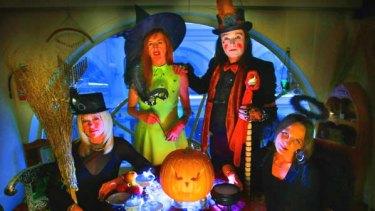 From left: Loretta Shirley, Danae Thorpe, Drew Sinton and Michelle Walker get into the pagan spirit of Halloween.