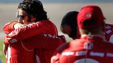 Dario Franchitti, driver of the #10 Target Chip Ganassi Racing Dallara Honda consoles a crew member after Dan Wheldon's death.