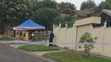 Police at the Moonee Ponds crime scene on Monday morning.
