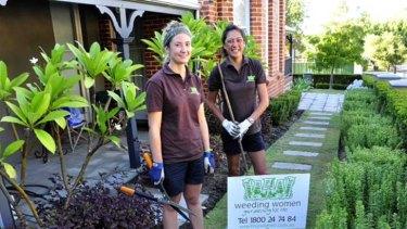 A green thumb ... Weeding women.