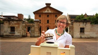 Greenaway's vision ... Kate Clark at Hyde Park Barracks with a model of the restoration.