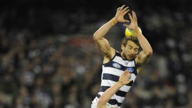 Geelong's Corey Enright spoils teammate Josh Hunt and Fremantle's Matt de Boer at the MCG last night.