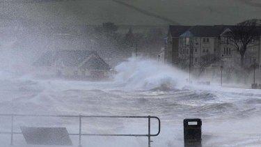 Large seas ... waves crash against the promenade in Largs.