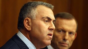 Treasurer Joe Hockey with Prime Minister Tony Abbott: The urgency of a budget deficit may be exaggerated, according to leading economists.