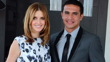 Dressed to impress: Kate Waterhouse with soccer player Tim Cahill, in a Shoreditch suit.