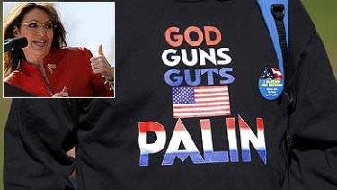 A supporter wearing a sweatshirt attends a Tea Party Express rally in Boston where Sarah Palin, inset, spoke.