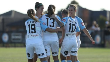 Rebekah Stott of Melbourne City celebrates a goal against Brisbane Roar.