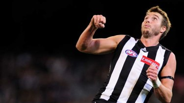Climbing high: Collingwood's Dale Thomas uses Taylor Hunt as a step-ladder on Friday night.