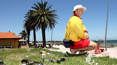 Lifeguard Matt Culka with some of the rubbish left on the St Kilda foreshore after New Year celebrations last January.