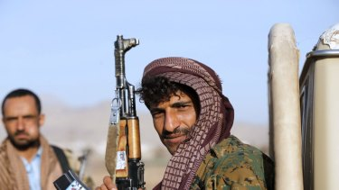 A Houthi fighter near the presidential palace in Sanaa on Thursday.