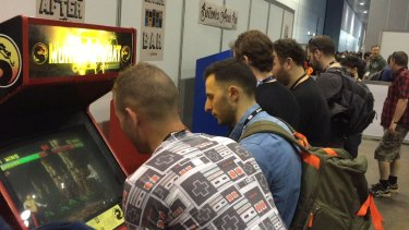 Friends challenging each other to Mortal Kombat at PAX Australia.