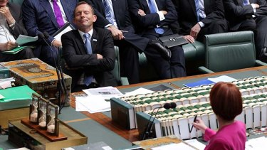 """A continuing """"witch-hunt"""" ... Opposition Leader Tony Abbott and Prime Minister Julia Gillard during Question Time in Parliament."""