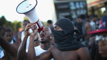 Demonstrators protest the killing by police of unarmed teenager Michael Brown.