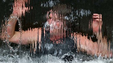 Cooling off ... John O'Reilly takes refuge in the fountain in Martin Place.