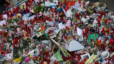 Flowers, messages and candles form a memorial tribute to the victims of terrorists.