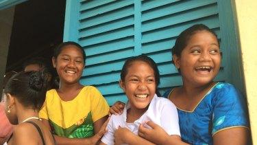 Tuvaluan girls outside church.