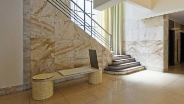 Smooth operation: Original terrazzo floors and marble walls have been complemented by sympathetic finishes.