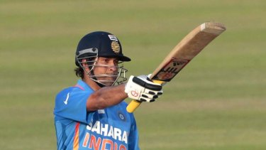 Sachin Tendulkar acknowledges the applause after reaching his 100th international hundred.