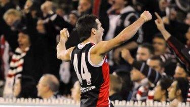 Stephen Milne celebrates his third goal.