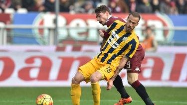 Victory target: Vangelis Moras, front, in Serie A action for Hellas Verona.