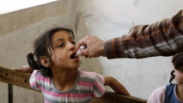 Health dose: A child receives a polio vaccination in Aleppo, Syria, in May.