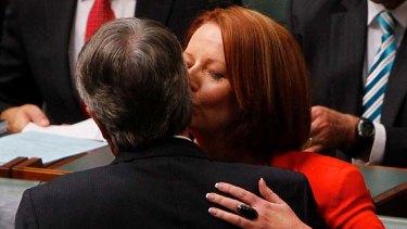 Prime Minister Julia Gillard embraces Treasurer Wayne Swan after he delivered the Budget Address in Parliament House.