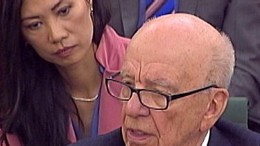 Out of touch ...  Rupert Murdoch answers a question as his wife Wendi Deng looks on.