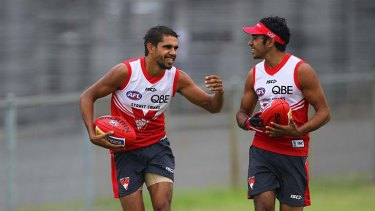 Dedicated ... Swans speedster Lewis Jetta shares a laugh with teammate Byron Sumner at training this week.