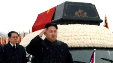 Family ties: Kim Jong-un salutes beside the hearse carrying the body of his father in December 2011, with uncle Jang Song-thaek a few steps behind.