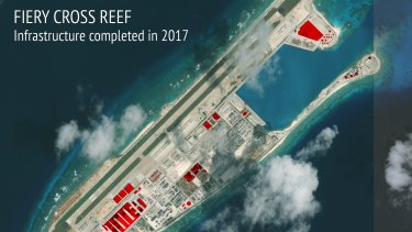 This image provided by CSIS Asia Maritime Transparency Initiative/DigitalGlobe shows a satellite image of Fiery Cross Reef in Spratly island chain in the South China Sea, annotated by the source to show areas where China has conducted construction work above ground during 2017.