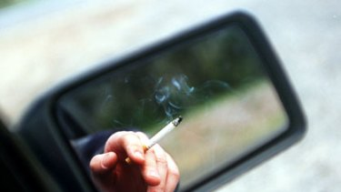 Smoking in cars with other passengers may be banned in Queensland.