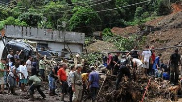 Rescue workers search for victims after heavy rains caused mudslides in a low-income neughbourhood in Teresopolis, some 100 km from downtown Rio de Janeiro.