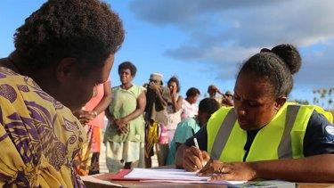 Red Cross volunteers in Vanuatu assess people's needs after cyclone Pam in March.