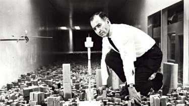 Alexander Wargon inspects the Sydney Tower plans circa. 1976.