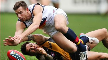 Richmond's Aaron Edwards and Adelaide's Andrew Otten scramble for possession.