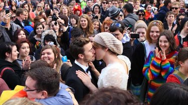 Show of support ... gay couples rally to support marriage equality.