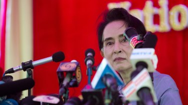 Myanmar's opposition leader Aung San Suu Kyi addresses the media at a press conference at her home in Yangon, Myanmar, on Thursday, before Sunday's elections.