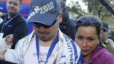 Angelica Alvarez embraces her husband, Chilean miner Edison Pena, after he crossed the finish line in the New York City Marathon  on Sunday.